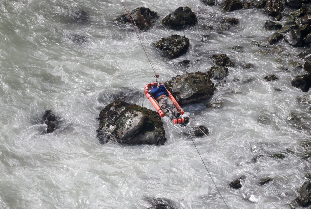 "<div class=""meta image-caption""><div class=""origin-logo origin-image none""><span>none</span></div><span class=""caption-text"">An injured man is transported over water from a bus that fell off a cliff after it was hit by a tractor-trailer rig, in Pasamayo, Peru, Tuesday, Jan. 2, 2018. (Vidal Tarky/Andina News Agency via AP)</span></div>"