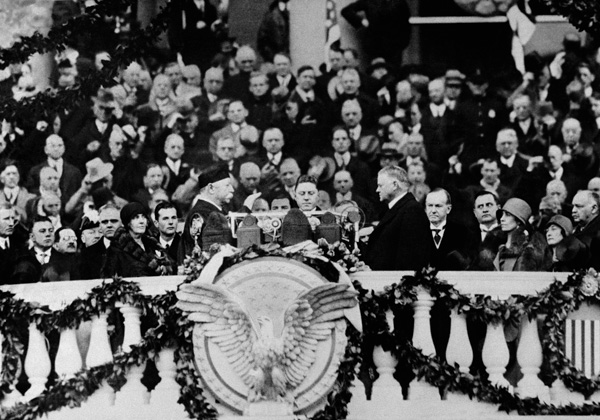 <div class='meta'><div class='origin-logo' data-origin='AP'></div><span class='caption-text' data-credit='AP Photo'>Herbert Hoover takes the oath of office from Chief Justice William Howard Taft as 31st president of the United States in Washington, March 4, 1929.</span></div>