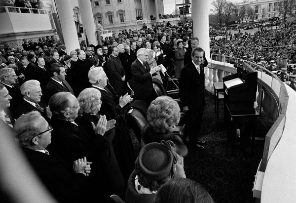<div class='meta'><div class='origin-logo' data-origin='none'></div><span class='caption-text' data-credit='AP Photo'>President Nixon acknowledges the applause after delivering his inaugural address during his second inauguration at the Capitol in Washington, D.C., Jan. 20, 1973.</span></div>