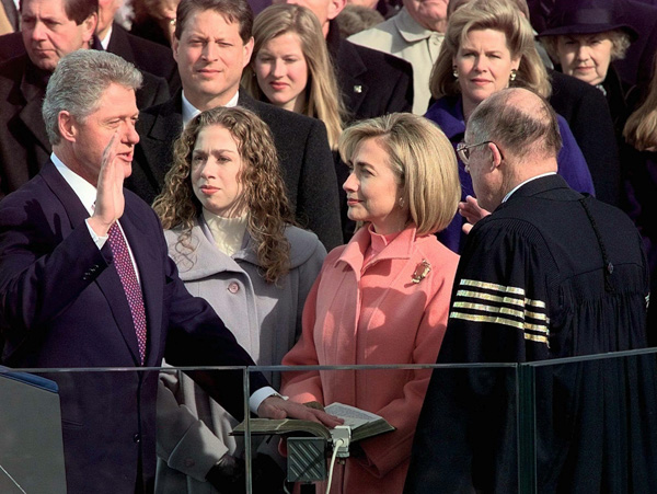 <div class='meta'><div class='origin-logo' data-origin='none'></div><span class='caption-text' data-credit='Doug Mills/AP Photo'>Supreme Court Chief Justice William Rehnquist administers the presidential oath to President Clinton, Monday Jan. 20, 1997 on Capitol Hill.</span></div>