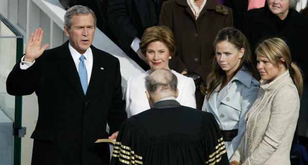 <div class='meta'><div class='origin-logo' data-origin='none'></div><span class='caption-text' data-credit='Stephan Savoia/AP Photo'>President Bush is sworn in by Chief Justice William Rehnquist during his inauguration on Capitol Hill Thursday, Jan. 20, 2005.</span></div>