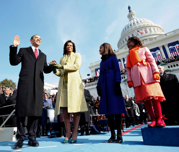 <div class='meta'><div class='origin-logo' data-origin='none'></div><span class='caption-text' data-credit='Chuck Kennedy/AP Photo'>Barack Obama takes the oath of office as his wife Michelle, holds the Lincoln Bible and daughters Sasha and Malia watch at the U.S. Capitol in Washington, Tuesday, Jan. 20, 2009.</span></div>