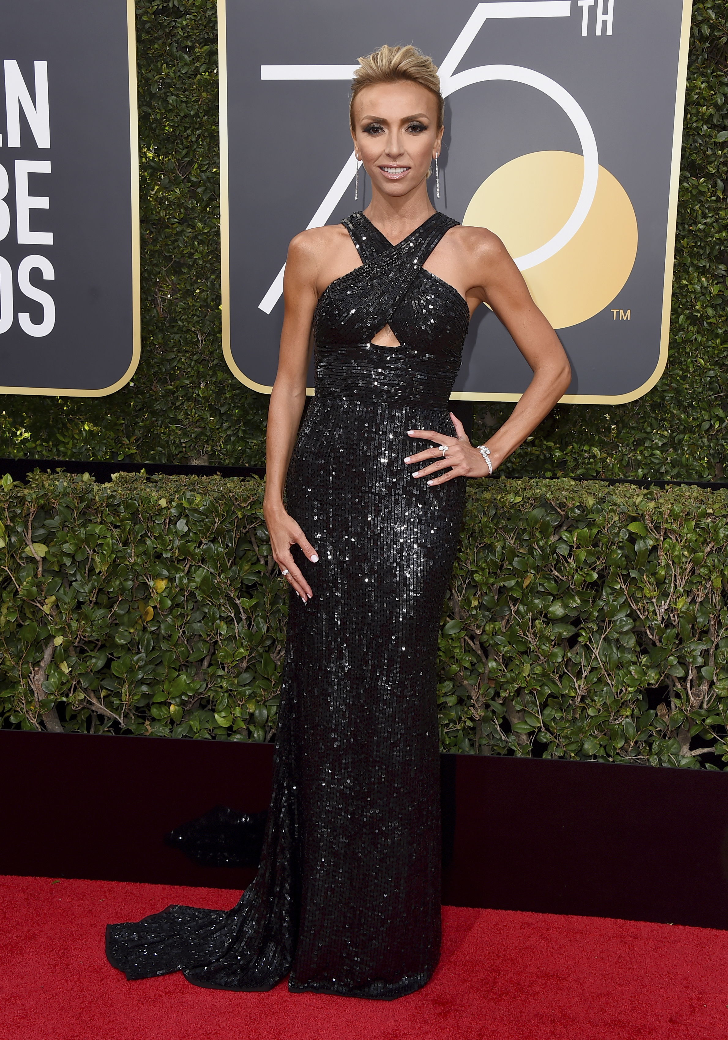 <div class='meta'><div class='origin-logo' data-origin='AP'></div><span class='caption-text' data-credit='Jordan Strauss/Invision/AP'>Giuliana Rancic arrives at the 75th annual Golden Globe Awards at the Beverly Hilton Hotel on Sunday, Jan. 7, 2018, in Beverly Hills, Calif.</span></div>