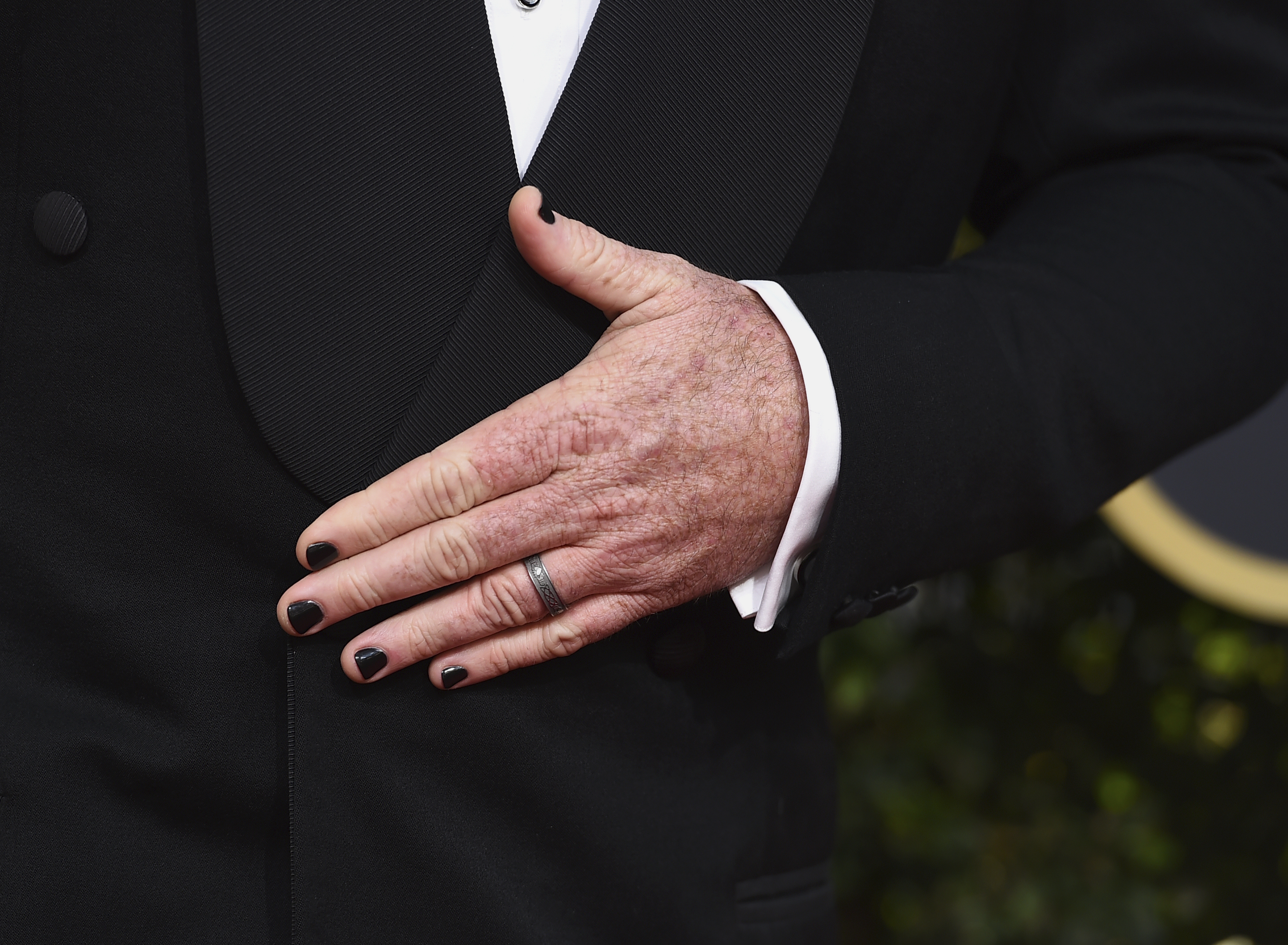 <div class='meta'><div class='origin-logo' data-origin='AP'></div><span class='caption-text' data-credit='Jordan Strauss/Invision/AP'>Chris Sullivan wears black nail polish as he arrives at the 75th annual Golden Globe Awards at the Beverly Hilton Hotel on Sunday, Jan. 7, 2018, in Beverly Hills, Calif.</span></div>