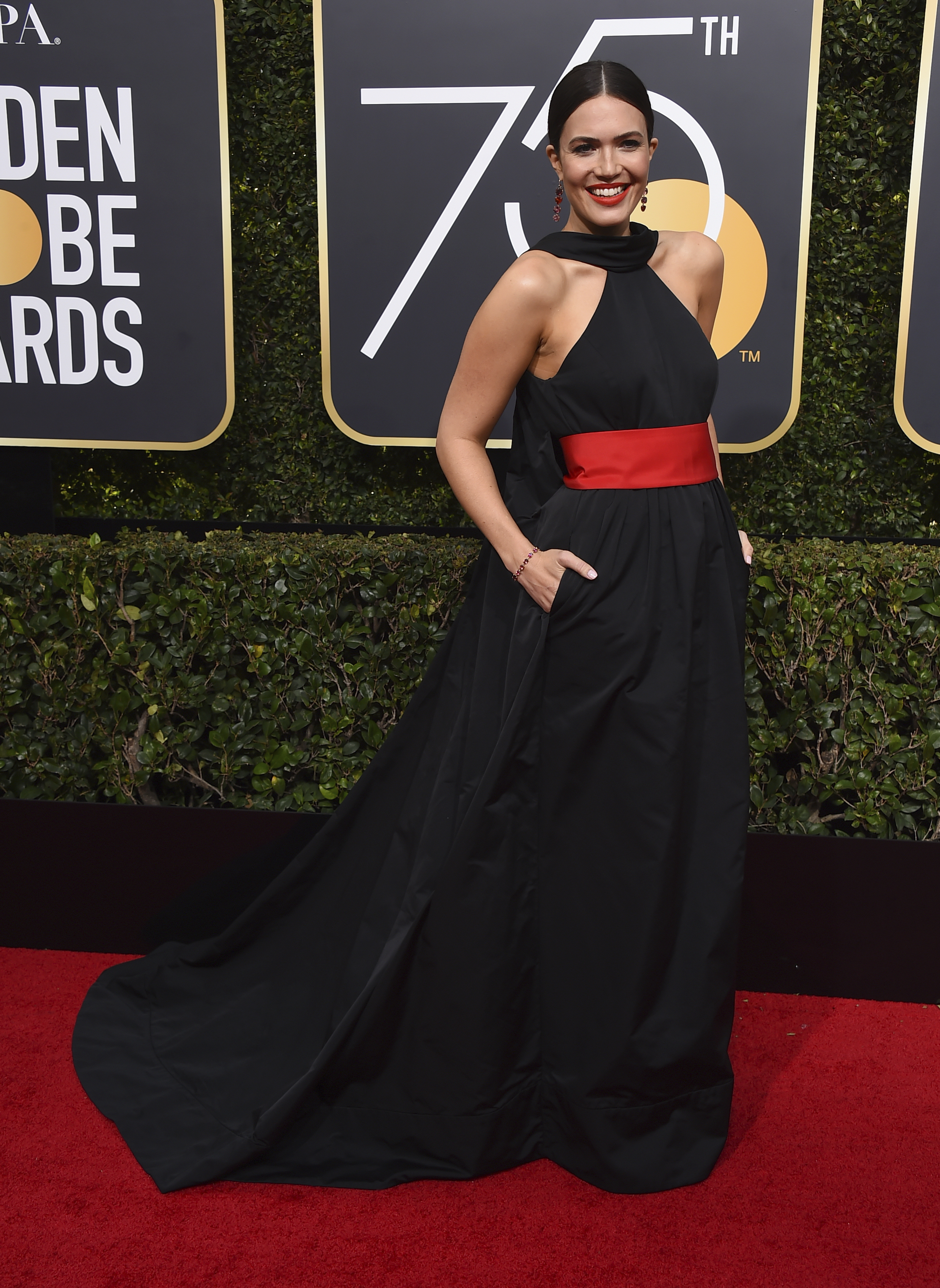 <div class='meta'><div class='origin-logo' data-origin='AP'></div><span class='caption-text' data-credit='Jordan Strauss/Invision/AP'>Mandy Moore arrives at the 75th annual Golden Globe Awards at the Beverly Hilton Hotel on Sunday, Jan. 7, 2018, in Beverly Hills, Calif.</span></div>