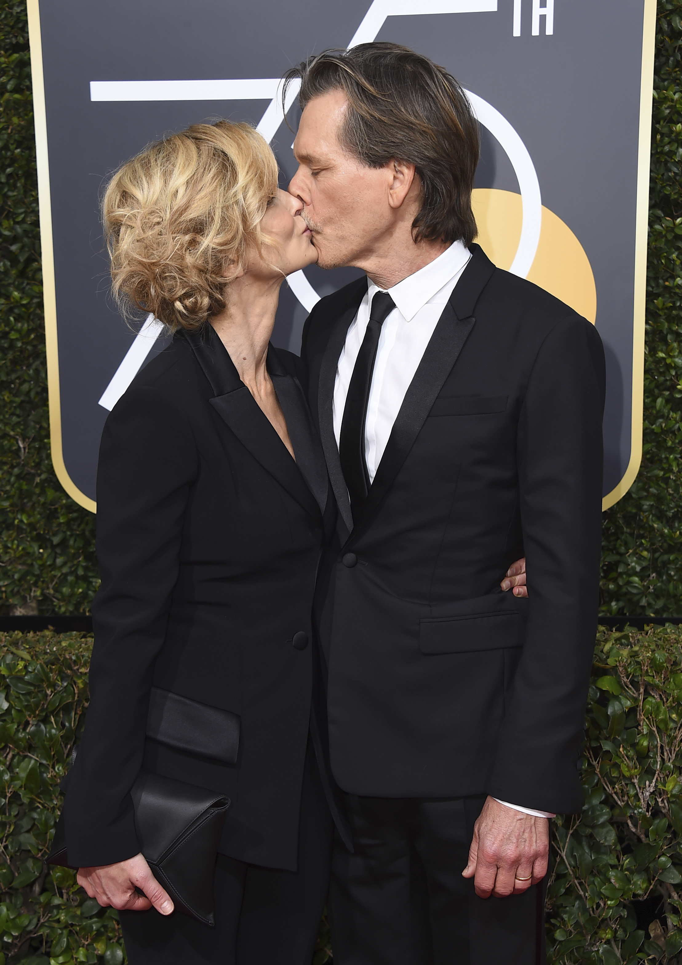 <div class='meta'><div class='origin-logo' data-origin='AP'></div><span class='caption-text' data-credit='Jordan Strauss/Invision/AP'>Kyra Sedgwick, left, and Kevin Bacon kiss as they arrive at the 75th annual Golden Globe Awards at the Beverly Hilton Hotel on Sunday, Jan. 7, 2018, in Beverly Hills, Calif.</span></div>
