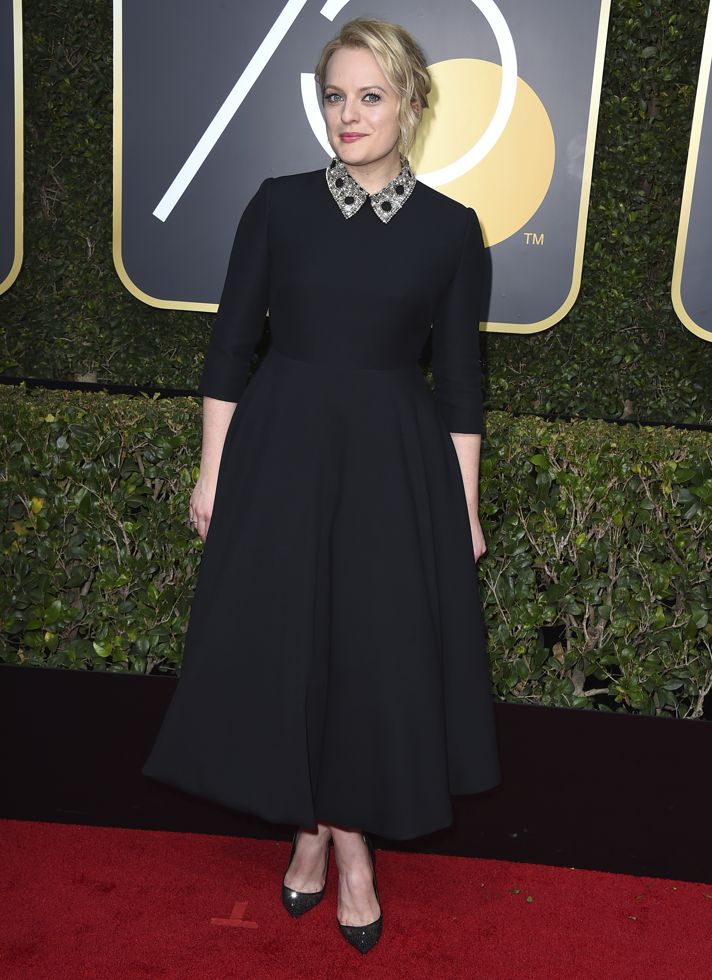 <div class='meta'><div class='origin-logo' data-origin='AP'></div><span class='caption-text' data-credit='Jordan Strauss/Invision/AP'>Elisabeth Moss arrives at the 75th annual Golden Globe Awards at the Beverly Hilton Hotel on Sunday, Jan. 7, 2018, in Beverly Hills, Calif.</span></div>