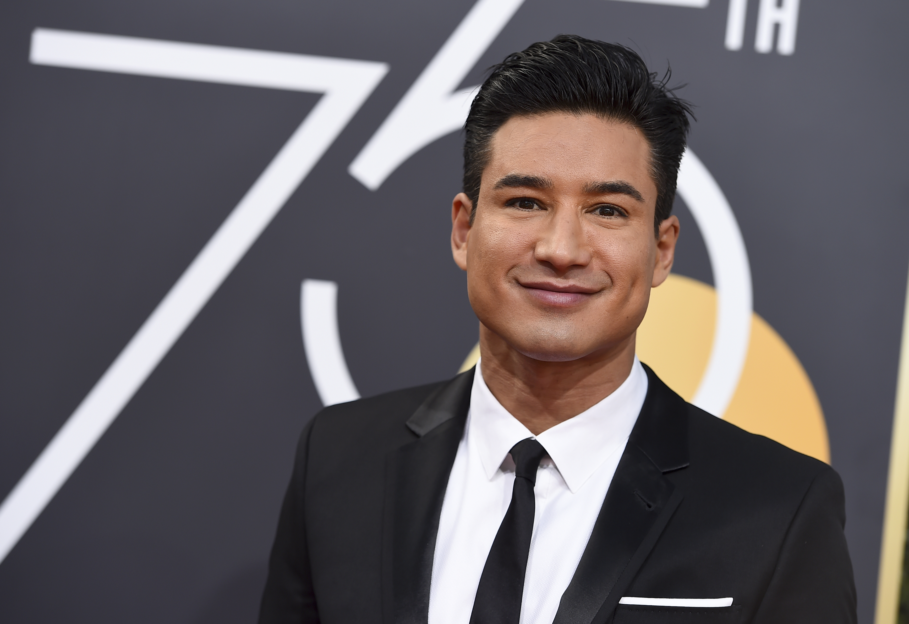 <div class='meta'><div class='origin-logo' data-origin='AP'></div><span class='caption-text' data-credit='Jordan Strauss/Invision/AP'>Mario Lopez arrives at the 75th annual Golden Globe Awards at the Beverly Hilton Hotel on Sunday, Jan. 7, 2018, in Beverly Hills, Calif.</span></div>