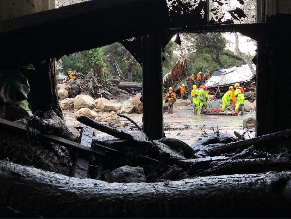 <div class='meta'><div class='origin-logo' data-origin='none'></div><span class='caption-text' data-credit='EliasonMike/Twitter'>&#34;Scene from the 300 block of Hot Springs Road in Montecito following debris and mud flow due to heavy rain.&#34;</span></div>