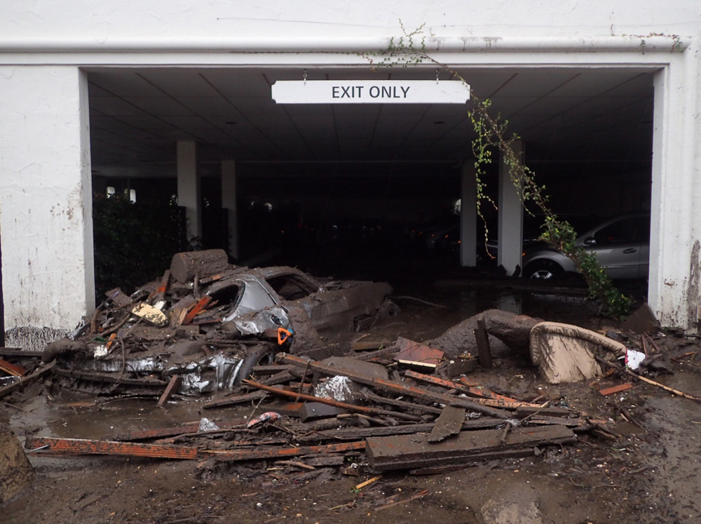 <div class='meta'><div class='origin-logo' data-origin='none'></div><span class='caption-text' data-credit='@EliasonMike/Twitter'>&#34;Damaged vehicles carried by mud flow and debris at the exit of the parking garage to The Montecito Inn at the corner of Olive Mill and Coast Village Road.&#34;</span></div>