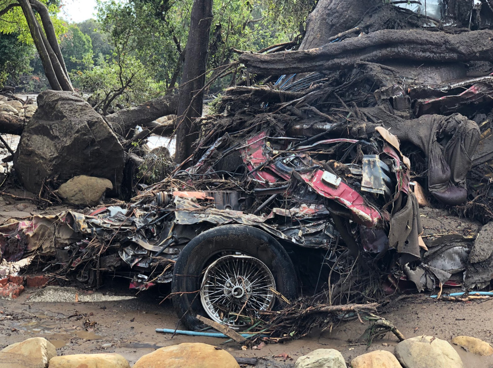 <div class='meta'><div class='origin-logo' data-origin='none'></div><span class='caption-text' data-credit='Santa Barbara County Fire'>&#34;A vehicle was wrapped and tangled around a tree by the force of deadly flood waters on Hot Springs Road in Montecito.&#34;</span></div>