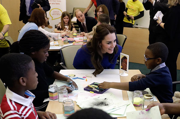 <div class='meta'><div class='origin-logo' data-origin='none'></div><span class='caption-text' data-credit='Matt Dunham, Pool/AP Photo'>Kate the Duchess of Cambridge speaks to families who have experienced bereavement during their visit to a Child Bereavement UK Centre in Stratford in east London on Jan. 11.</span></div>