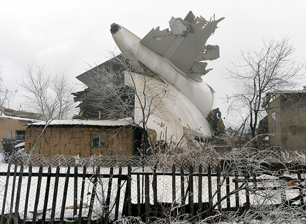 <div class='meta'><div class='origin-logo' data-origin='none'></div><span class='caption-text' data-credit='Vladimir Voronin/AP Photo'>The tail of a crashed Turkish Boeing 747 cargo plane lies at a residential area outside Bishkek, Kyrgyzstan Monday, Jan. 16, 2017.</span></div>