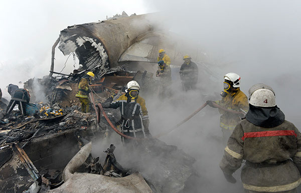 <div class='meta'><div class='origin-logo' data-origin='none'></div><span class='caption-text' data-credit='Vladimir Voronin/AP Photo'>Kyrgyz firefighters work among remains of a crashed Turkish Boeing 747 cargo plane at a residential area outside Bishkek, Kyrgyzstan Monday, Jan. 16, 2017.</span></div>