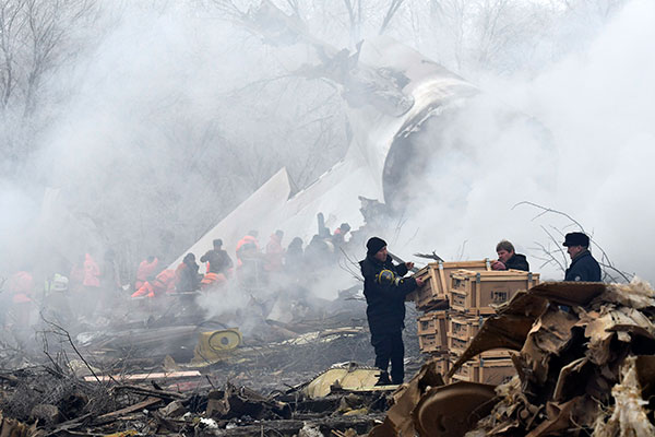 <div class='meta'><div class='origin-logo' data-origin='none'></div><span class='caption-text' data-credit='Vladimir Voronin/AP Photo'>Kyrgyz Emergency Ministry officials work among remains of a crashed Turkish Boeing 747 cargo plane at a residential area outside Bishkek, Kyrgyzstan Monday, Jan. 16, 2017.</span></div>