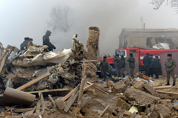 <div class='meta'><div class='origin-logo' data-origin='none'></div><span class='caption-text' data-credit='Vladimir Voronin/AP Photo'>Remains of a crashed Turkish Boeing 747 cargo plane are at a residential area outside Bishkek, Kyrgyzstan Monday, Jan. 16, 2017.</span></div>