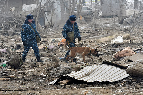 <div class='meta'><div class='origin-logo' data-origin='none'></div><span class='caption-text' data-credit='Vladimir Voronin/AP Photo'>Kyrgyz soldiers with a sniffer dog search among remains of a crashed Turkish Boeing 747 cargo plane at a residential area outside Bishkek, Kyrgyzstan Monday, Jan. 16, 2017.</span></div>