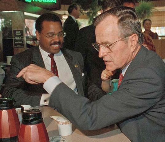 <div class='meta'><div class='origin-logo' data-origin='AP'></div><span class='caption-text' data-credit='AP'>Former President George H.W. Bush</span></div>