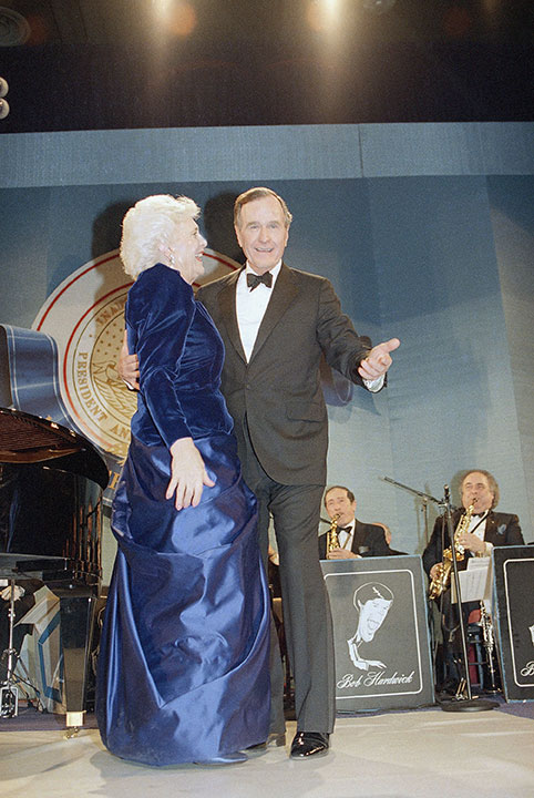 <div class='meta'><div class='origin-logo' data-origin='none'></div><span class='caption-text' data-credit=''>U.S. President and Mrs. Bush dance during an inaugural ball at the Washington Convention Center at night, Friday, Jan. 21, 1989.</span></div>