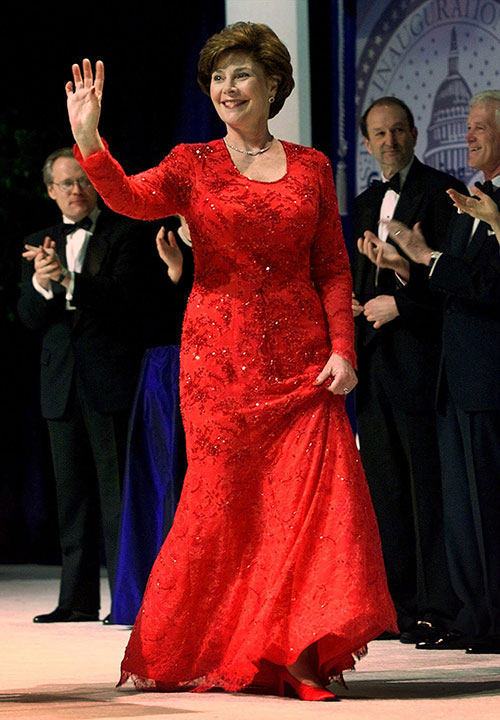 "<div class=""meta image-caption""><div class=""origin-logo origin-image none""><span>none</span></div><span class=""caption-text"">This Jan. 20, 2001 file photo shows first lady Laura Bush waving as she arrives on stage for a Presidential Inaugural Ball at the Marriott Wardman Park Hotel in Washington. (Doug Mills, File/AP Photo)</span></div>"