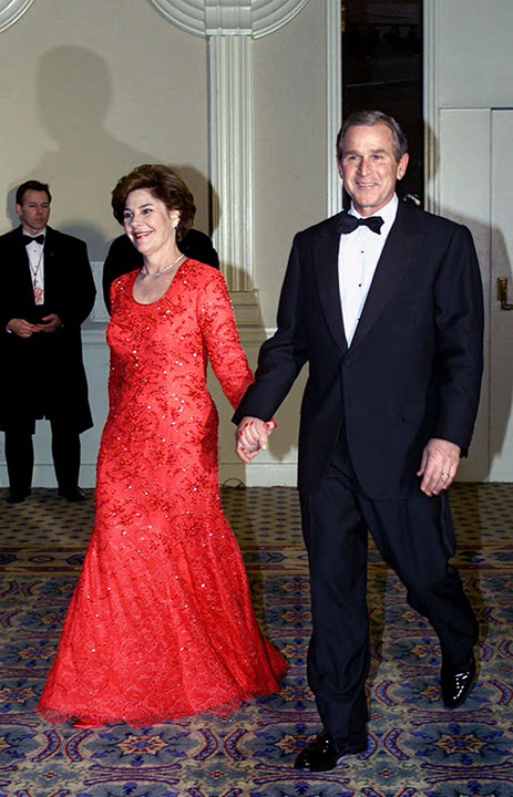 <div class='meta'><div class='origin-logo' data-origin='none'></div><span class='caption-text' data-credit='Doug Mills/AP Photo'>President and Mrs. Bush smile as they are welcomed by supporters at the Salute to Heroes and Veterans Banquet in Washington, Saturday, Jan. 20, 2001.</span></div>