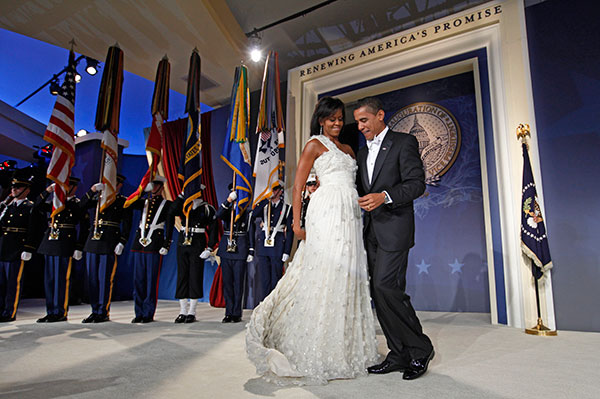 <div class='meta'><div class='origin-logo' data-origin='none'></div><span class='caption-text' data-credit='Charles Dharapak/AP Photo'>First lady Michelle Obama moves her dress train as she dances with President Barack Obama at the Youth Inaugural Ball in Washington, Tuesday, Jan. 20, 2009.</span></div>
