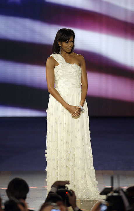 <div class='meta'><div class='origin-logo' data-origin='none'></div><span class='caption-text' data-credit='Alex Brandon/AP Photo'>First lady Michelle Obama acknowledges applause as she arrives at the Neighborhood Inaugural Ball in Washington, Tuesday, Jan. 20, 2009.</span></div>