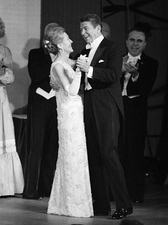 <div class='meta'><div class='origin-logo' data-origin='none'></div><span class='caption-text' data-credit='AP Photo, File'>In this Jan. 20, 1981 file photo, President Ronald Reagan and first lady Nancy Reagan dance at an inaugural ball at the Pension Building in Washington.</span></div>