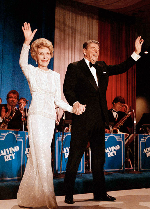 <div class='meta'><div class='origin-logo' data-origin='none'></div><span class='caption-text' data-credit='Ira Schwarz/AP Photo'>In this Jan. 21, 1985 file photo, President Ronald Reagan and first lady Nancy Reagan arrive at the inaugural ball in the Washington Hilton.</span></div>