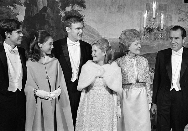 <div class='meta'><div class='origin-logo' data-origin='none'></div><span class='caption-text' data-credit='AP Photo'>President Nixon, right, and his family prepare to leave the White House to attend six inaugural balls, in Washington, D.C., Jan. 20, 1969.</span></div>