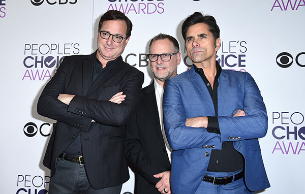 "<div class=""meta image-caption""><div class=""origin-logo origin-image none""><span>none</span></div><span class=""caption-text"">Bob Saget, Dave Coulier, and John Stamos, winners of the award for favorite premium comedy series for ""Fuller House,"" pose in the press room at the People's Choice Awards. (Jordan Strauss/Invision/AP)</span></div>"