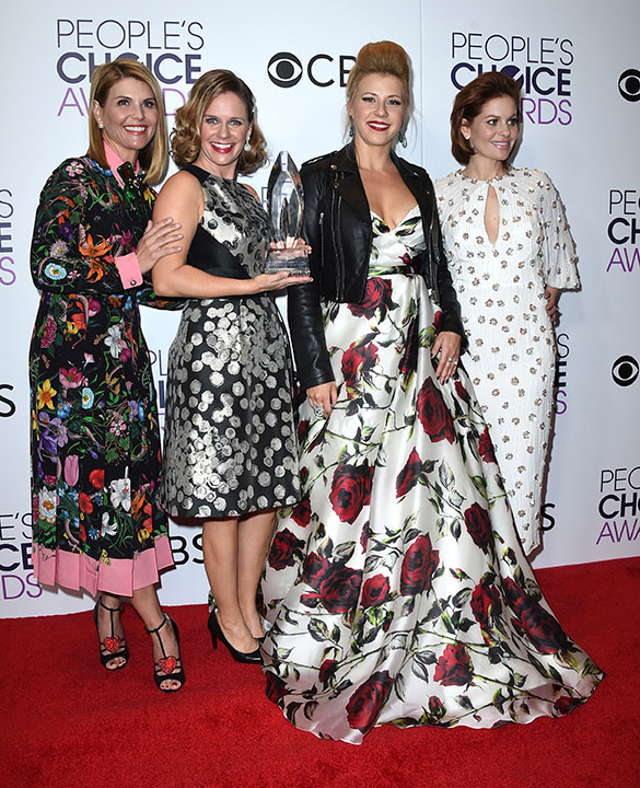 "<div class=""meta image-caption""><div class=""origin-logo origin-image none""><span>none</span></div><span class=""caption-text"">Lori Loughlin, from left, Andrea Barber, Jodie Sweetin, and Candace Cameron-Bure pose in the press room with the award for favorite premium comedy series for ''Fuller House.'' (Jordan Strauss/Invision/AP)</span></div>"