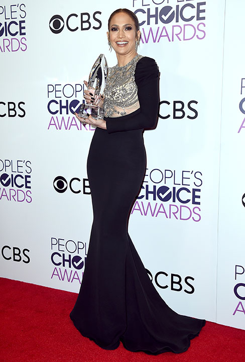 "<div class=""meta image-caption""><div class=""origin-logo origin-image none""><span>none</span></div><span class=""caption-text"">Jennifer Lopez poses in the press room with the award for favorite TV crime drama actress at the People's Choice Awards at the Microsoft Theater on Wednesday, Jan. 18, 2017. (Jordan Strauss/Invision/AP)</span></div>"