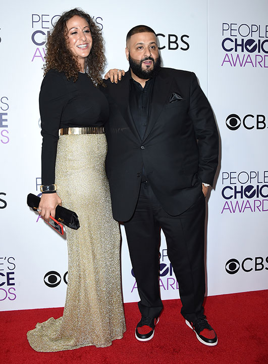 "<div class=""meta image-caption""><div class=""origin-logo origin-image none""><span>none</span></div><span class=""caption-text"">Nicole Tuck, left, and DJ Khaled pose in the press room at the People's Choice Awards at the Microsoft Theater on Wednesday, Jan. 18, 2017, in Los Angeles. (Jordan Strauss/Invision/AP)</span></div>"