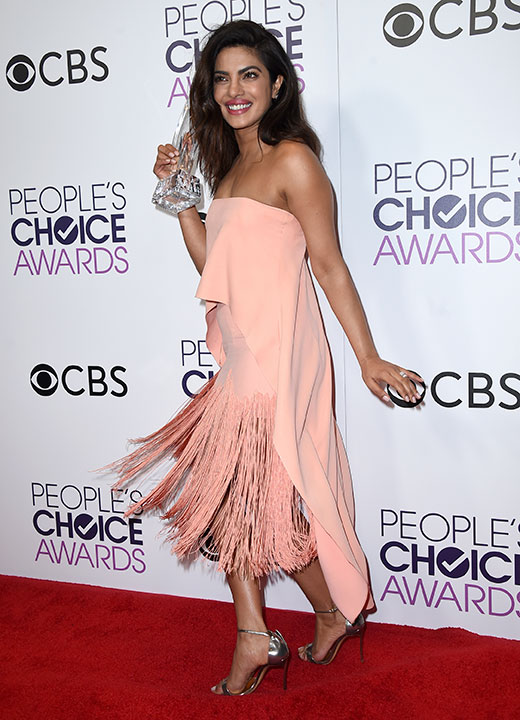 "<div class=""meta image-caption""><div class=""origin-logo origin-image none""><span>none</span></div><span class=""caption-text"">Priyanka Chopra poses in the press room with the award for favorite TV drama actress at the People's Choice Awards at the Microsoft Theater on Wednesday, Jan. 18, 2017. (Jordan Strauss/Invision/AP)</span></div>"