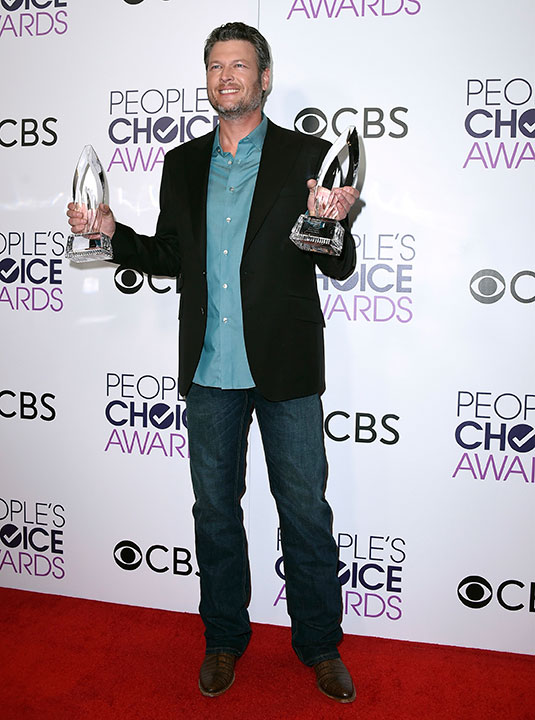 "<div class=""meta image-caption""><div class=""origin-logo origin-image none""><span>none</span></div><span class=""caption-text"">Blake Shelton poses in the press room with the awards for favorite album for ""If I'm Honest"" and favorite country male artist at the People's Choice Awards at the Microsoft Theater (Jordan Strauss/Invision/AP)</span></div>"