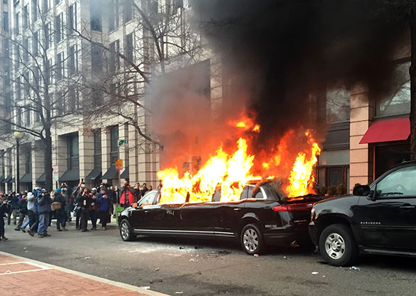 <div class='meta'><div class='origin-logo' data-origin='none'></div><span class='caption-text' data-credit='Juliet Linderman/AP Photo'>Protesters set a parked limousine on fire in downtown Washington, Friday, Jan. 20, 2017, during the inauguration of President Donald Trump.</span></div>