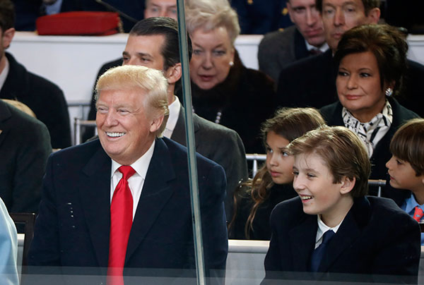 <div class='meta'><div class='origin-logo' data-origin='none'></div><span class='caption-text' data-credit='Pablo Martinez Monsivais/AP Photo'>President Donald Trump smiles with his son Barron as they view the 58th Presidential Inauguration parade for President Donald Trump in Washington. Friday, Jan. 20, 2017.</span></div>