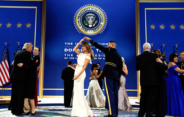 <div class='meta'><div class='origin-logo' data-origin='none'></div><span class='caption-text' data-credit='Alex Brandon/AP Photo'>President Donald Trump dances with Navy Petty Officer 2nd Class Catherine Cartmell as first lady Melania Trump is spun by Army Staff Sgt. Jose A. Medina at a ball on Jan. 21, 2017.</span></div>