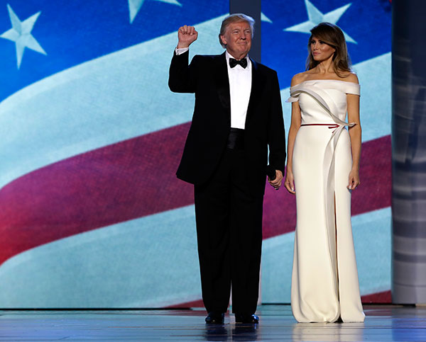 <div class='meta'><div class='origin-logo' data-origin='none'></div><span class='caption-text' data-credit='Evan Vucci/AP Photo'>President Donald Trump acknowledges the crowd with first lady Melania Trump at the Freedom Ball, Friday, Jan. 20, 2017, in Washington.</span></div>