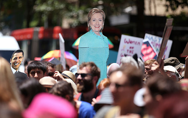 <div class='meta'><div class='origin-logo' data-origin='none'></div><span class='caption-text' data-credit='Rick Rycroft/AP Photo'>Images of Hillary Clinton and Barack Obama are carried as thousands file through the streets during the Women's March in Sydney, Australia on Saturday.</span></div>