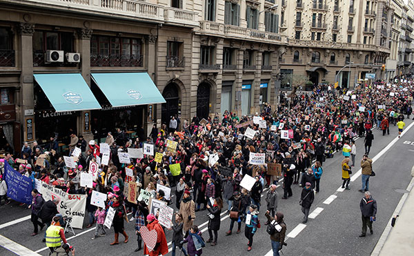 <div class='meta'><div class='origin-logo' data-origin='none'></div><span class='caption-text' data-credit='Manu Fernandez/AP Photo'>People take part during the Women's March rally in Barcelona, Spain, Saturday, Jan. 21, 2017.</span></div>