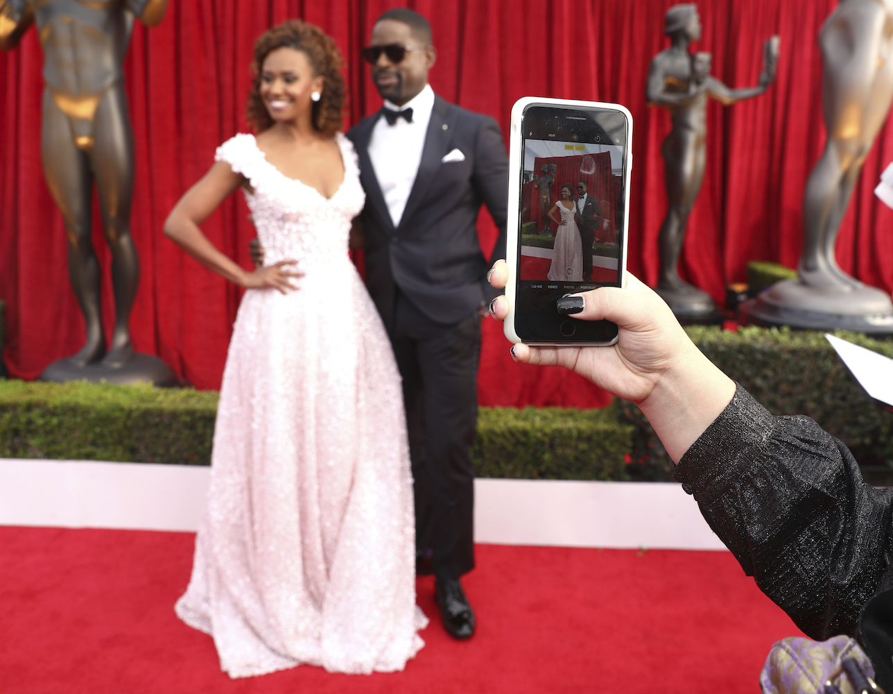 <div class='meta'><div class='origin-logo' data-origin='AP'></div><span class='caption-text' data-credit='Matt Sayles/Invision/AP'>A guest takes a photo of Sterling K. Brown, right, and Ryan Michelle Bathe at the 24th annual Screen Actors Guild Awards.</span></div>