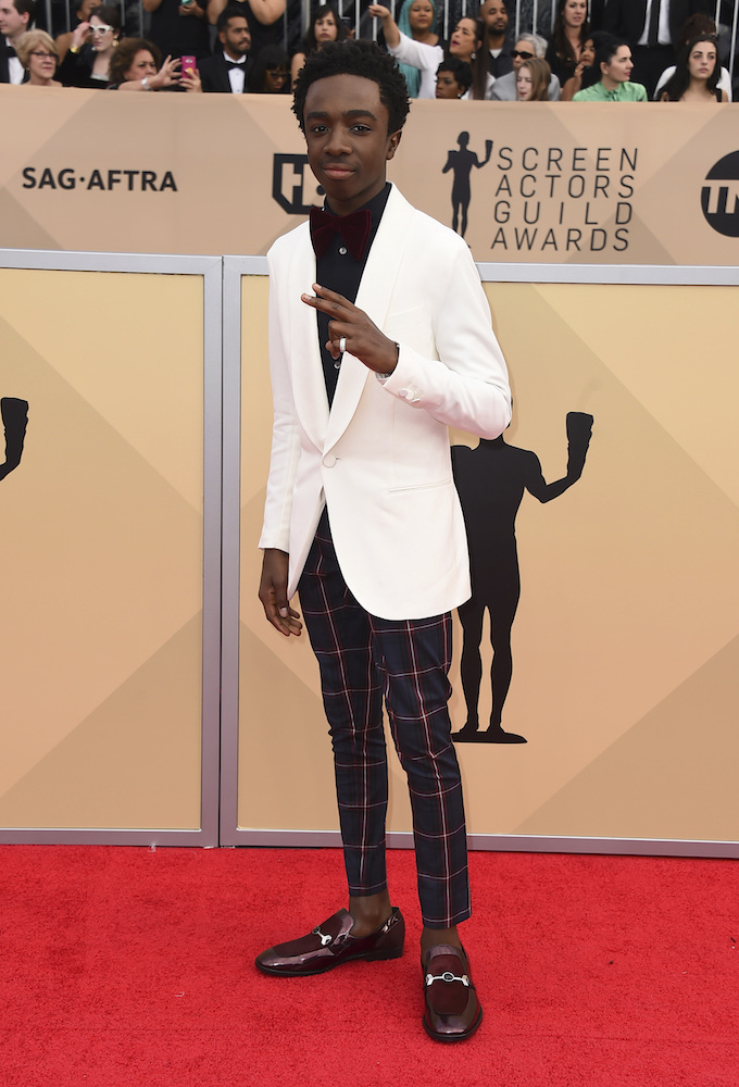 <div class='meta'><div class='origin-logo' data-origin='AP'></div><span class='caption-text' data-credit='Jordan Strauss/Invision/AP'>Caleb McLaughlin arrives at the 24th annual Screen Actors Guild Awards at the Shrine Auditorium & Expo Hall on Sunday, Jan. 21, 2018, in Los Angeles.</span></div>