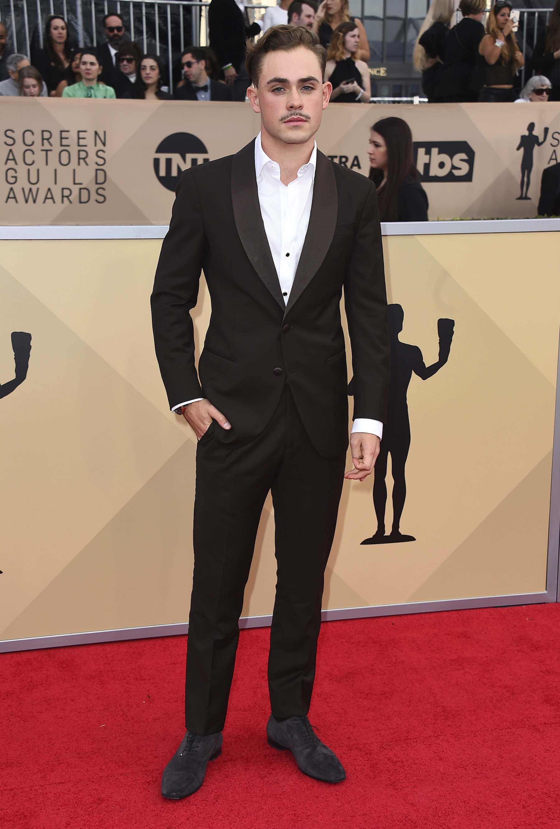 <div class='meta'><div class='origin-logo' data-origin='AP'></div><span class='caption-text' data-credit='Jordan Strauss/Invision/AP'>Dacre Montgomery arrives at the 24th annual Screen Actors Guild Awards at the Shrine Auditorium & Expo Hall on Sunday, Jan. 21, 2018, in Los Angeles.</span></div>