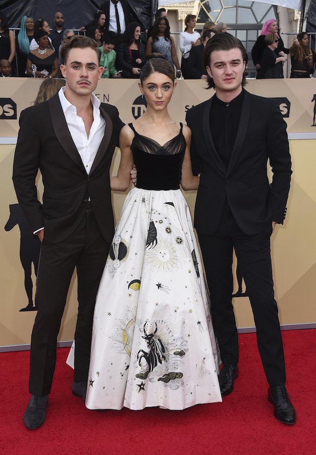<div class='meta'><div class='origin-logo' data-origin='AP'></div><span class='caption-text' data-credit='Jordan Strauss/Invision/AP'>Dacre Montgomery, from left, Natalia Dyer, and Joe Keery arrive at the 24th annual Screen Actors Guild Awards at the Shrine Auditorium & Expo Hall.</span></div>