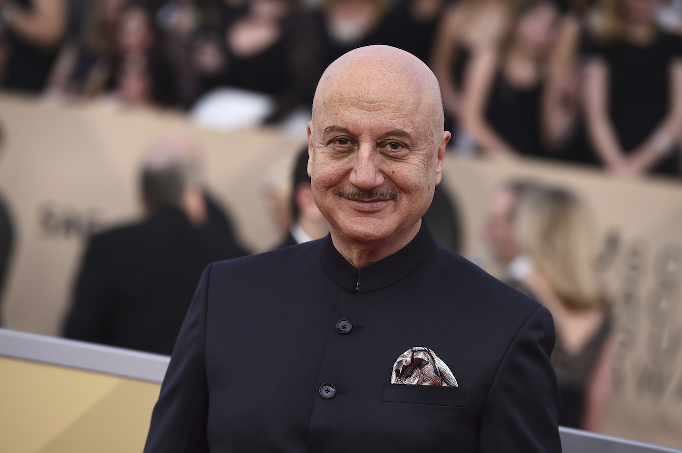 <div class='meta'><div class='origin-logo' data-origin='AP'></div><span class='caption-text' data-credit='Jordan Strauss/Invision/AP'>Anupam Kher arrives at the 24th annual Screen Actors Guild Awards at the Shrine Auditorium & Expo Hall on Sunday, Jan. 21, 2018, in Los Angeles.</span></div>