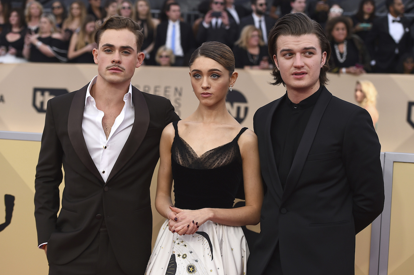 <div class='meta'><div class='origin-logo' data-origin='AP'></div><span class='caption-text' data-credit='Jordan Strauss/Invision/AP'>Dacre Montgomery, from left, Natalia Dyer, and Joe Keery arrive at the 24th annual Screen Actors Guild Awards at the Shrine Auditorium & Expo Hall on Sunday, Jan. 21, 2018.</span></div>