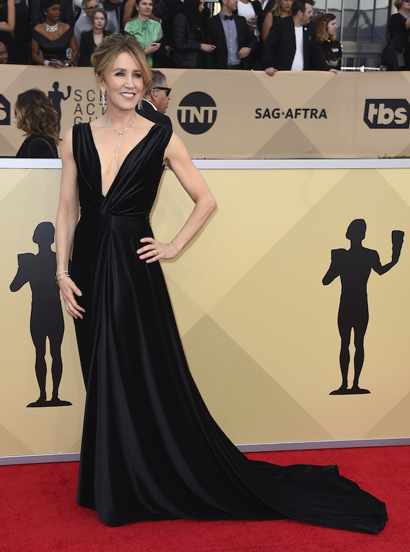 <div class='meta'><div class='origin-logo' data-origin='AP'></div><span class='caption-text' data-credit='Jordan Strauss/Invision/AP'>Felicity Huffman arrives at the 24th annual Screen Actors Guild Awards at the Shrine Auditorium & Expo Hall on Sunday, Jan. 21, 2018, in Los Angeles.</span></div>
