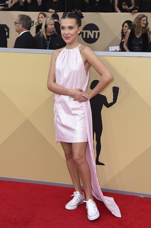 <div class='meta'><div class='origin-logo' data-origin='AP'></div><span class='caption-text' data-credit='Jordan Strauss/Invision/AP'>Millie Bobby Brown arrives at the 24th annual Screen Actors Guild Awards at the Shrine Auditorium & Expo Hall on Sunday, Jan. 21, 2018, in Los Angeles.</span></div>